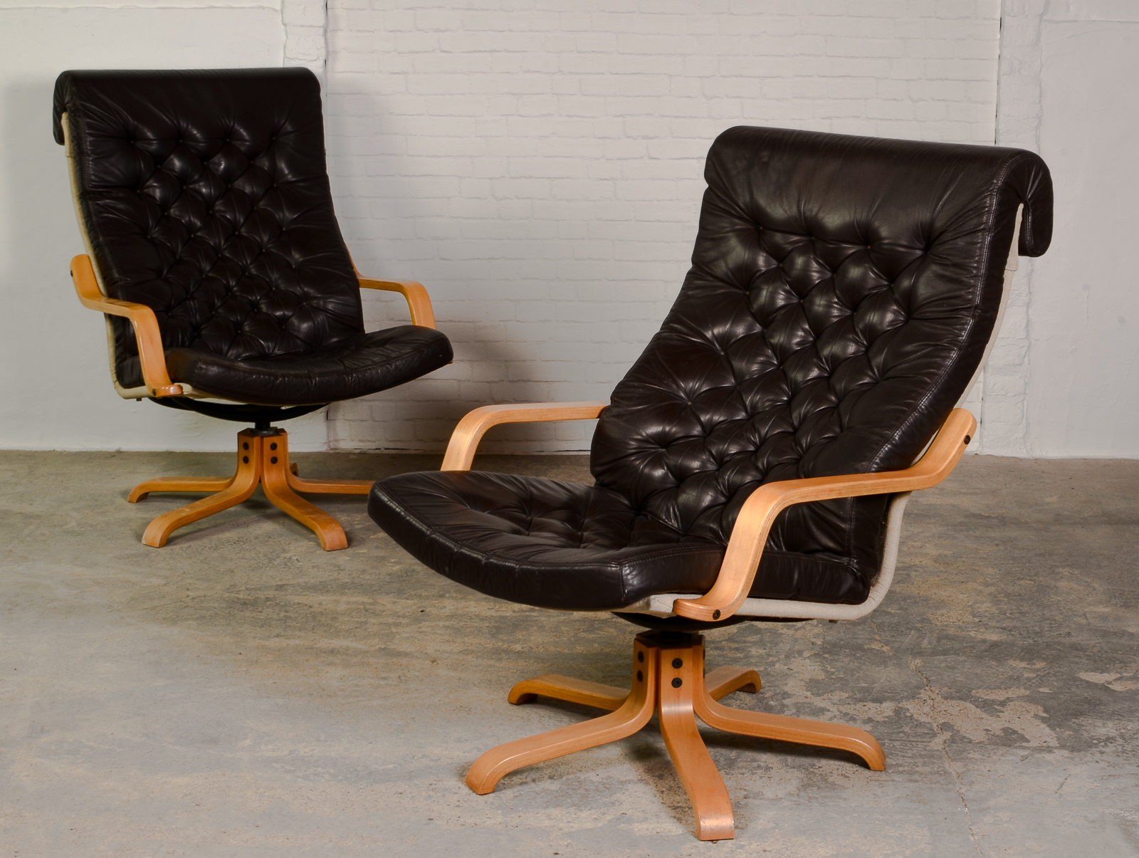 Pair Of Padded Leather Relax Swivel Chairs With Bended Wooden Frame