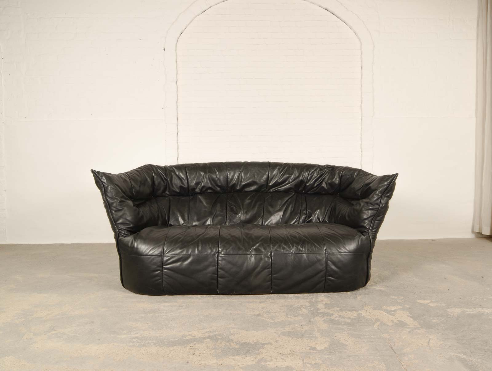 Mid Century Modern Pair of Black Leather Soft Shell Sofas for