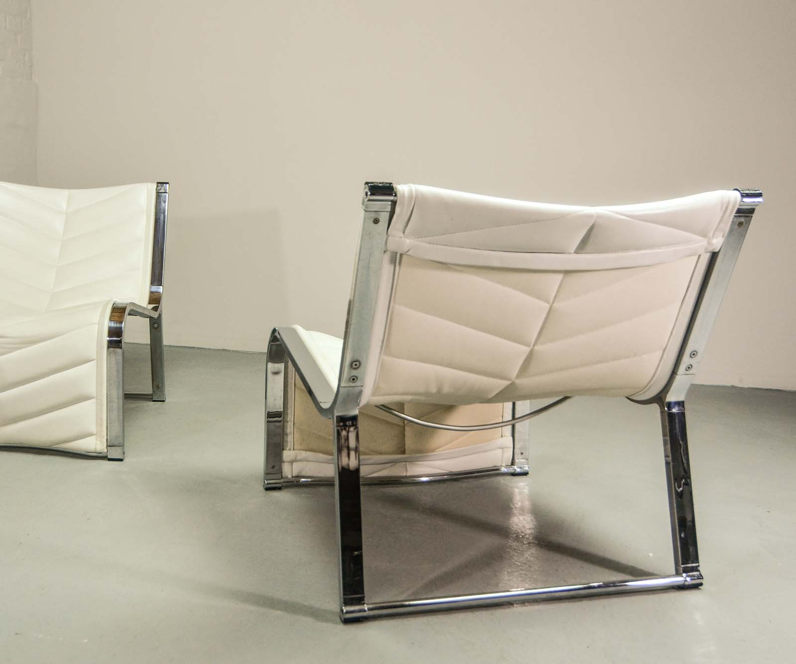 luxurious set of chrome and white leather lounge chairs by rossi