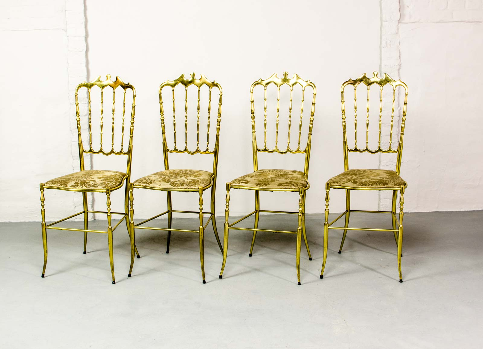 set of four midcentury italian brass chiavari spindle back chairs with padded seats upholstered